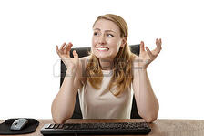 51713494-businesswoman-at-her-desk-looking-up-surprised-and-shocked-at-something-happening-in-the-office